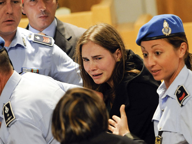 EMOTIONAL VERDICT: Amanda Knox cries Monday after an Italian appeals court threw out her murder conviction and ordered the young American freed after nearly four years in prison for the death of her British roommate. Her co-defendant, Raffaele Sollecito, also was cleared of killing 21-year-old Meredith Kercher in 2007.