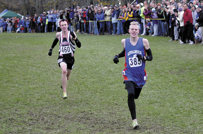 PHOTO FINISH: Scarborough's Nick Morris gains ground in the final stretch on Messalonskee's Harlow Ladd at the end of the Class A cross country state championships Saturday at Twin Brook Recreation Area in Cumberland. Morris caught Ladd and won a photo finish.