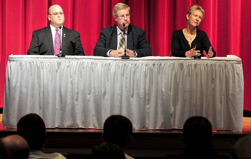 CAMPAIGN TRAIL: Candidates for Waterville mayor, from left, Andrew Roy, Dana Sennett and Karen Heck discuss issues during a forum Monday at Thomas College.