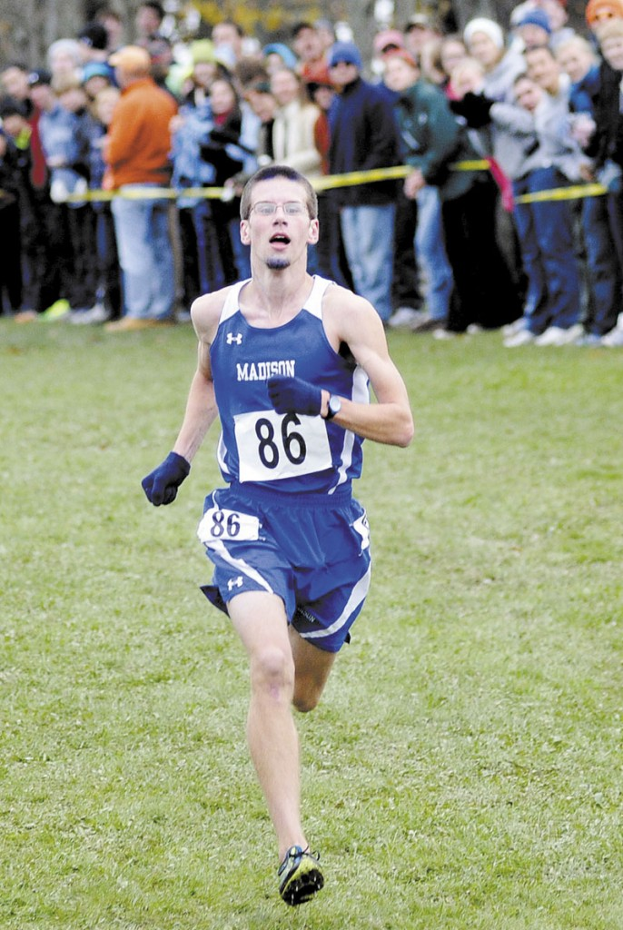 WINNER: Madison's Matthew McClintock races to the finish line during the Class C state cross country championships Saturday at Twin Brook Recreation Area in Cumberland. McClintock won the title in 15:52.91.