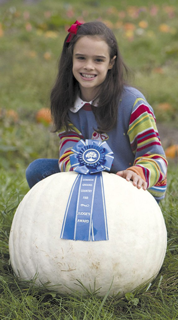NOW THAT'S A PUMPKIN: Sienna Mazone, 9, of Dresden, won first prize for a 65-pound white pumpkin grown using Johnny's Selected Seeds of Winslow in the Great Pumpkin Competition at the Common Ground Country Fair recently.