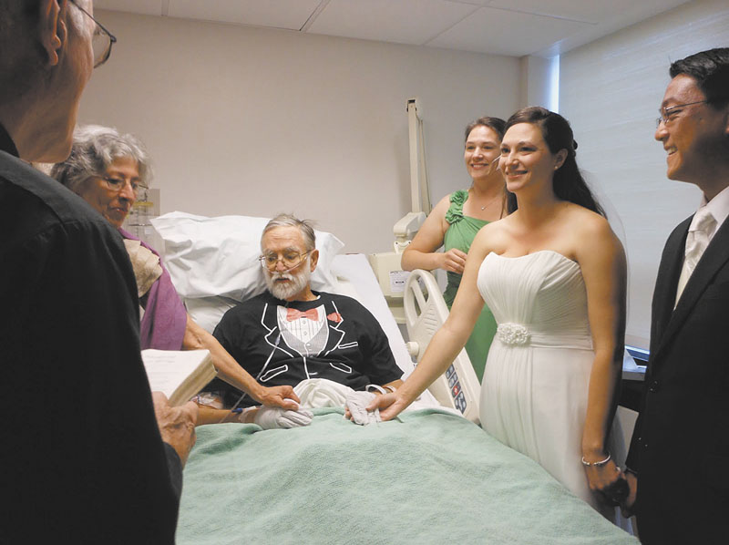 Brian Rines kept his promise to give his daughter away at her wedding recently, despite being stricken with pneumonia and leukemia. MaineGeneral Medical Center staff decorated the room in Augusta, and the bride and groom exchanged vows at Rines' bedside. From left are the Rev. Richard Johnson; Nancy Rines, mother of the bride; Rines, a forensic psychologist and former Gardiner mayor; Emily Rines Feeley, sister and matron of honor; bride Sarah Rines and groom Philip Javier-Wong.