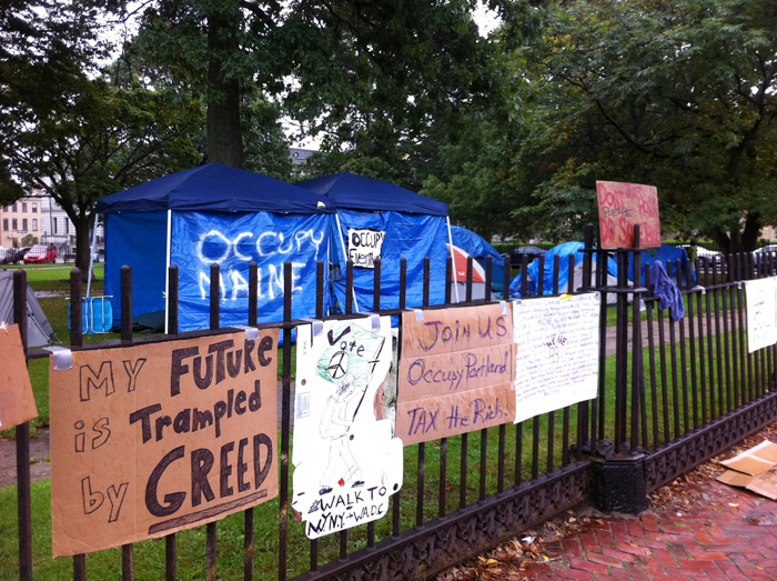 """""""Occupy"""" placards carry anti-greed message at Lincoln Park."""