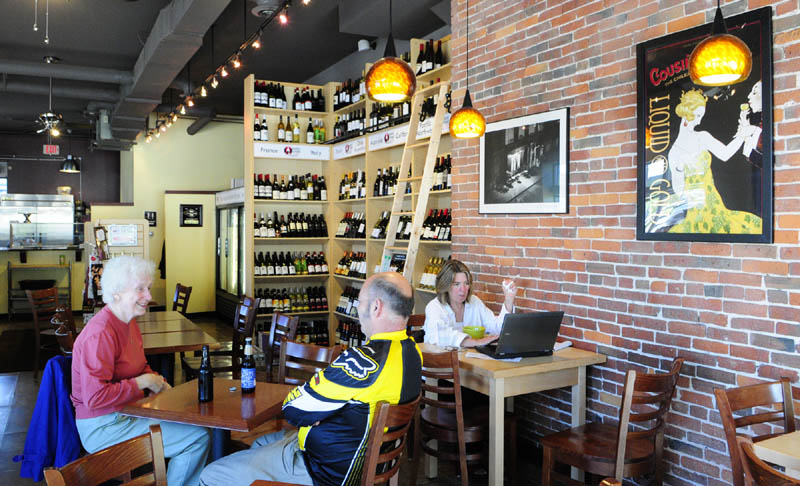 NEW SPOT: Customers sit in The Water Street Cafe last week in Gardiner. It is located at the corner of Bridge and Water streets.