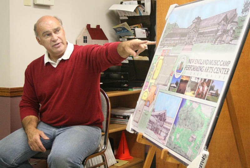 John Wiggin, director of the New England Music Camp, points to an illustration of a proposed addition during a meeting in Sidney on Monday.