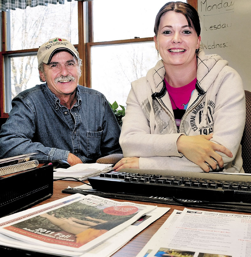 BACK TO SCHOOL: Jean Mason sits at a desk at the Franklin County Adult Education Center in Farmington. Beside her is Ray Therrien, who helped inspire Mason to seek new training with the Franklin County Community College Network.