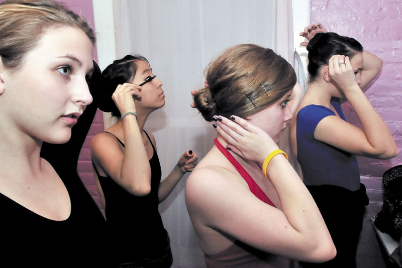 BACKSTAGE: Dancers with the Bossov Ballet Theatre get ready backstage for rehearsal at the Skowhegan Opera House. From left are Kelsey Hayes, Trinity Bachrach, Claire Kisev and Karyn Carlin.