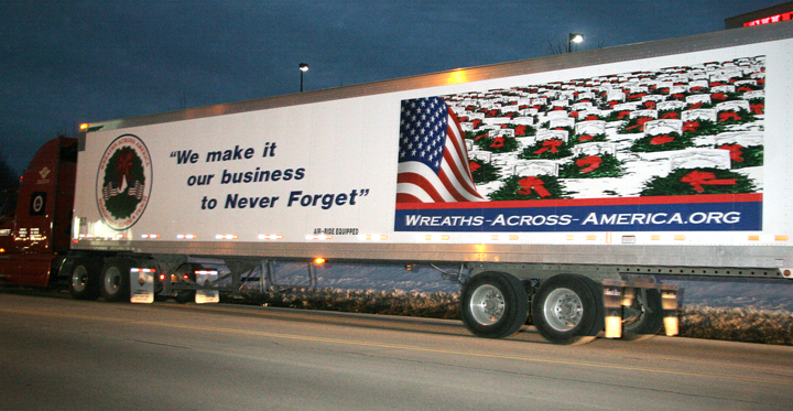 In this Dec. 10, 2007, photo, a tractor trailer from Worcester Wreath Co. in Harrington sets off on its trip to deliver thousands of holiday wreaths to Arlington National Cemetary in Virginia.