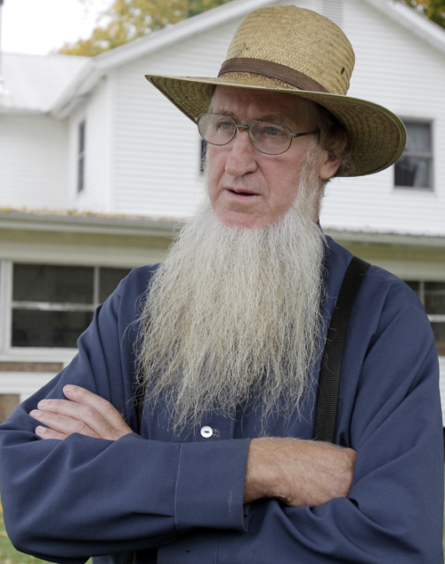 Sam Mullet stands in the front yard of his home in Bergholz, Ohio, in this Oct. 10, 2011, photo. The FBI and local sheriff's deputies arrested seven men, including Mullet, reputed leader of a breakaway Amish sect, on federal hate crime charges early today.