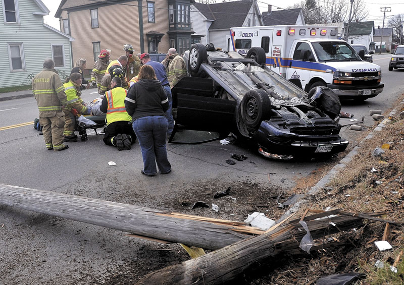 Fairfield firefighters and paramedics from Delta Ambulance treat a victim involved in an accident that sheared a utility pole on College Avenue in Fairfield on Saturday morning.