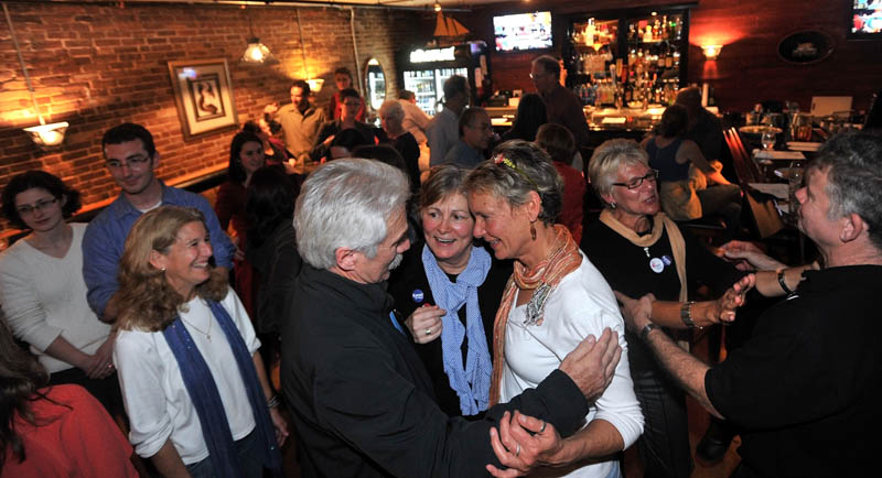 Mayor-elect Karen Heck, center, celebrates with supporters at 18 Below Raw Bar in Waterville Tuesday night after poll results filtered in.