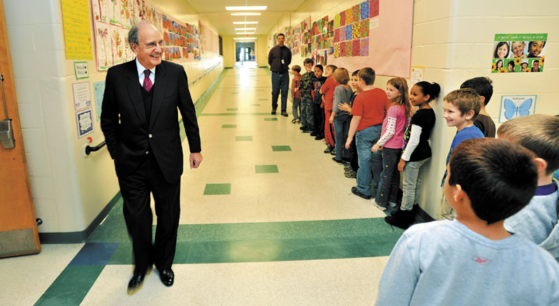 FRIENDLY FACES: Students from Mr. Dolloff's second-grade class say hello to Sen. George Mitchell, left, during a tour of the George Mitchell Elementary School recently in Waterville.