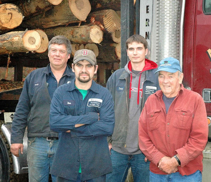 FAMILY AFFAIR: From left, Tracy Morrison, his sons, Ross Morrison and Kyle Morrison, and his father John Morrison stand for a photo. The family will mark 30 years in the forestry business in Harmony this fall.