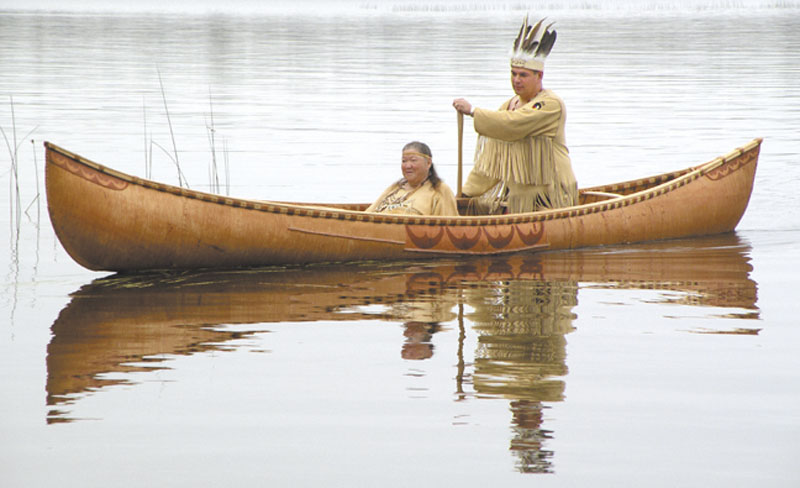 GOING FORWARD: This October 2011 photo provided by the Passamaquoddy tribe shows Chief Joseph Socobasin paddling a birch canoe with his grandmother Joan Dana in Indian Township. Tribal members built the canoe, a replica of one from the 1800s, using a single piece of birch bark. The tribe is looking to wind, water and land for other means of economic development.