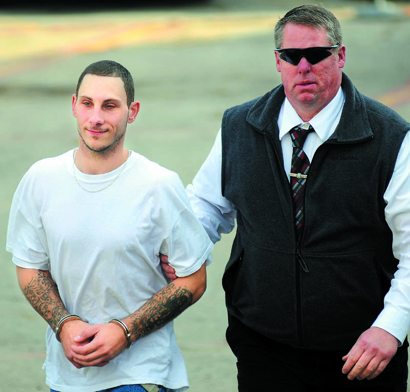 APPREHENDED: Ronald Willey, left, 28, is escorted to jail Thursday after being arrested in Augusta on charges of aggravated assault and terrorizing by Kennebec County Sheriff's Department Detective David Bucknam. Willey surrendered to police after allegedly attacking his girlfriend Sunday in Rome.