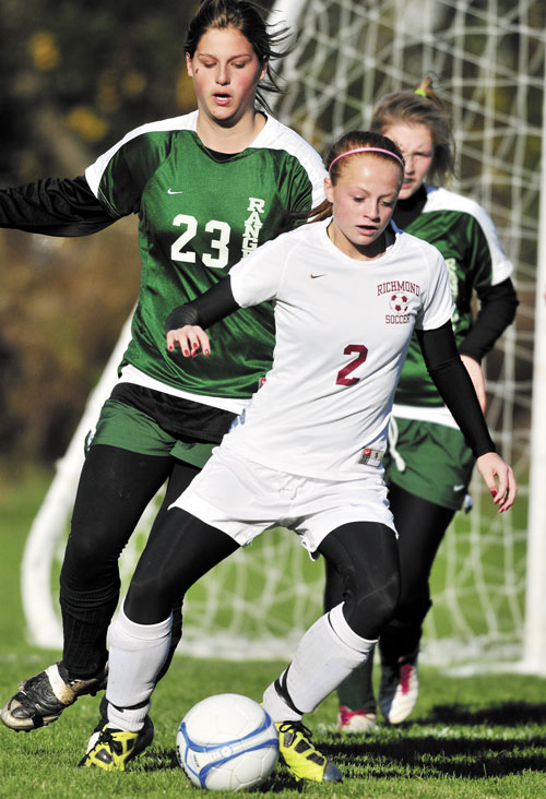 READY TO GO: Richmond High School's Noell Acord maneuvers around Rangeley Lakes Regional High School defenders during a Western Class D semifinal game Saturday in Richmond. The top-ranked Bobcats won 6-0 and will host No. 2 Greenville in the regional final at 1 p.m. today.