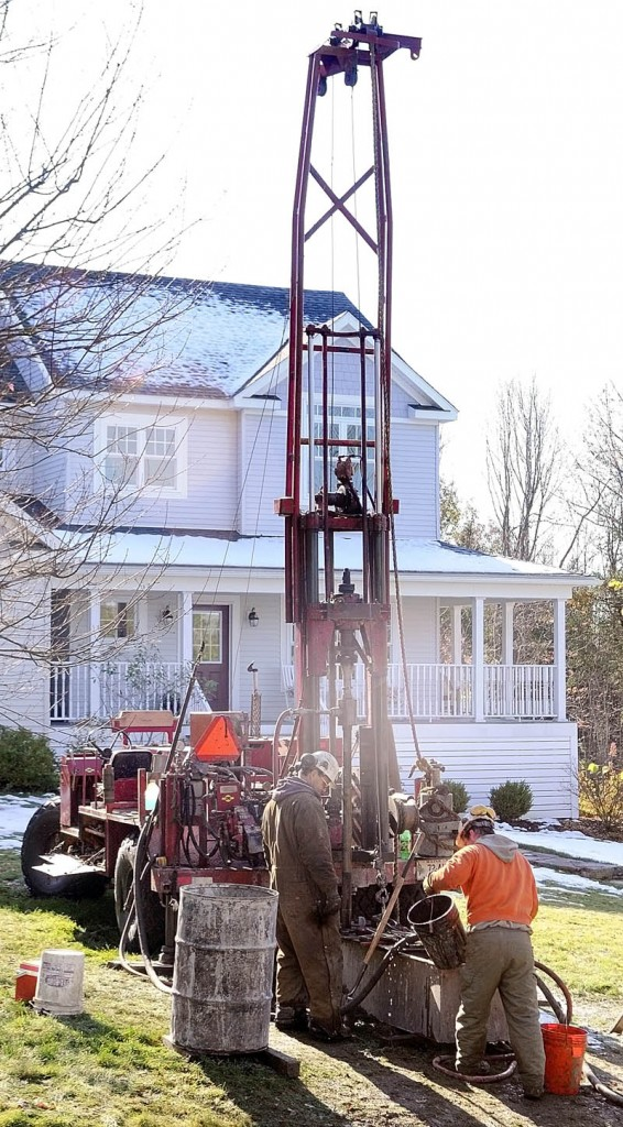 STILL DRILLING: Chris Palmer, left, and Chris Monroe, of East Coast Explorations, drill a bore hole in Peter Meulendyk's front lawn on Wednesday in Manchester.