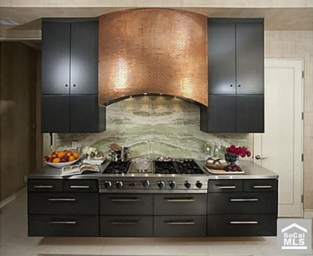 A California home that's for sale for $7.4 million includes this enormous stove with copper hood.
