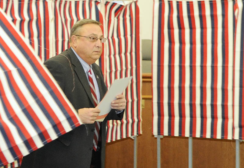 Gov. Paul LePage walks out of the polling booth this morning at Augusta City Hall. LePage, who moved to Blaine House in Augusta when he won last year's election, voted for the first time in his new city.