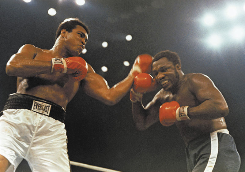 EPIC TRIOLOGY: Muhammad Ali, left, and Joe Frazier fought three times in their storied career, including this bout on Jan. 28, 1974 at Madison Square Garden. Frazier passed away Monday night at the age of 67. Boxing Heavyweight left punch l