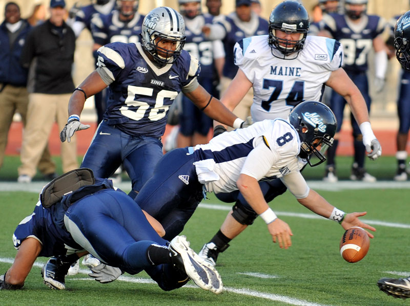 Quarterback Warren Smith (8) and the University of Maine football team earned a bye in the FCS playoffs.