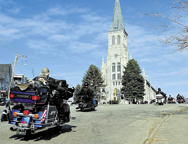 MOTORCYCLE MEMORIAL: About 40 motorcyclists arrive for the Memorial Mass of Christian burial for Simone M. Duplessis on Wednesday morning at St. Augustine Church in Augusta. The group — with members of the Combat Veterans Motorcycle Association and the Harley Owners Group Mid-Maine Chapter — met up and rode in from Lewiston in honor of their late friend.