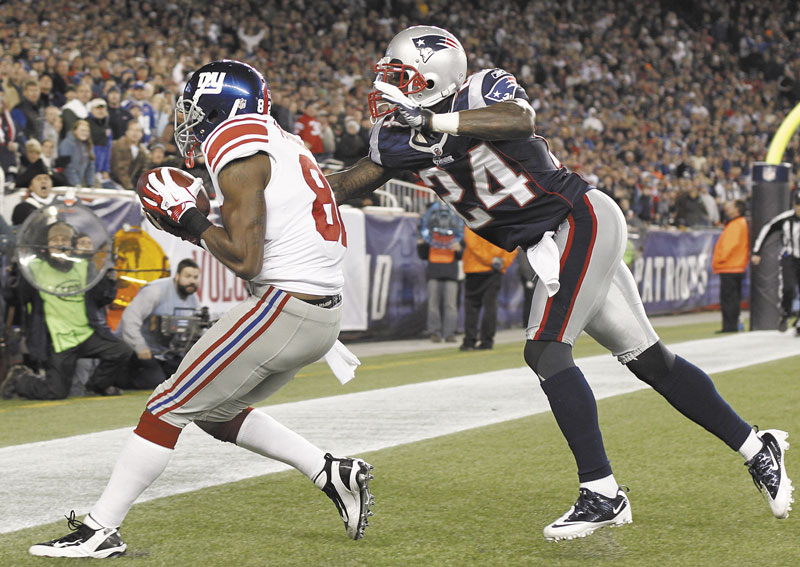 ANOTHER SCORE: New York Giants wide receiver Mario Manningham (82) catches the game-winning touchdown pass next to New England Patriots defensive back Kyle Arrington (24) in the fourth quarter last Sunday in Foxborough, Mass. The Patriots are allowing the most yards per game in the NFL.