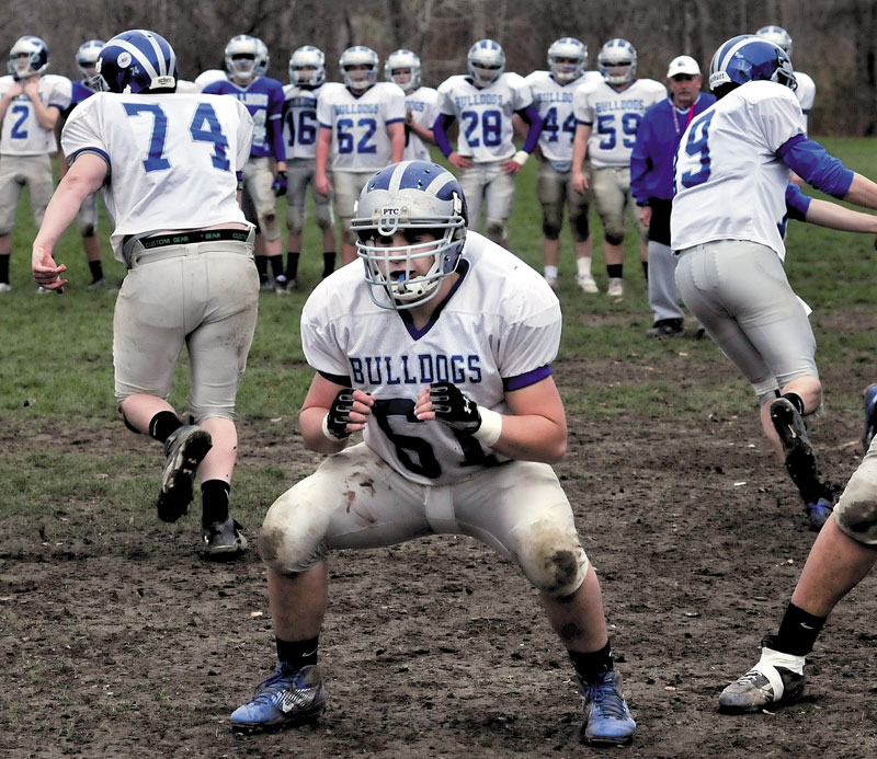 Josh Perry has been a starter on the Lawrence football team since 2009. He is following in the footsteps of his father John, who was a captain for the Bulldogs in 1980.