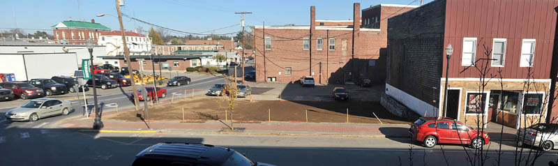 Open space replaces the spot where three buildings stood recently in downtown Skowhegan.