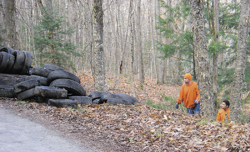 """LOOKING FOR CLUES: Bruce Inch, chairman of the Mount Vernon Board of Selectmen, is hoping that someone saw either the 200 tires being illegally dumped or a truck making numerous trips to the area. Inch said the tire pile """"was quite an impressive mess."""""""