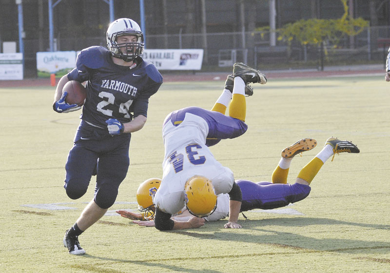 HE'S GONE: Yarmouth's Anders Overhaug, left, makes his way to the end zone for the first time Saturday. He found the end zone five more times as Yarmouth beat Bucksport 41-14 to win its second consecutive Class C state title.