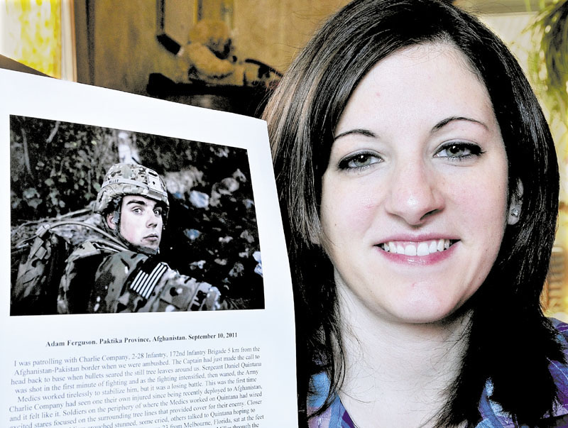 PRECIOUS PHOTO: On Tuesday Brittany Miller holds a Time magazine photograph of her husband Michael while he served in the U.S. Army in Afghanistan. The photograph was chosen for Time's Top 10 Photos of 2011.