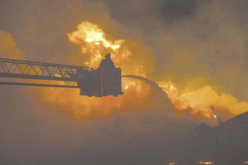 BATTLING: Flames engulf the barn at Knowlton Corner Farm in Farmington on Thursday.
