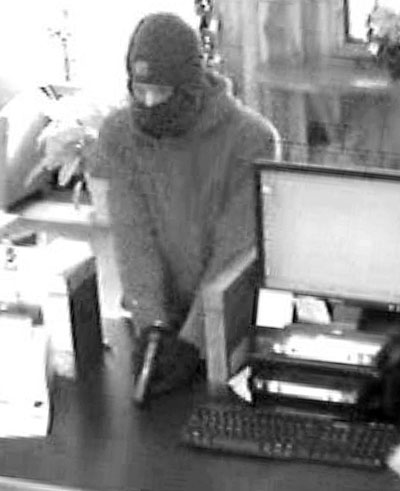 SUSPECT: A man who robbed Border Trust on Route 3 in South China on Friday is seen from the bank's surveillance camera.