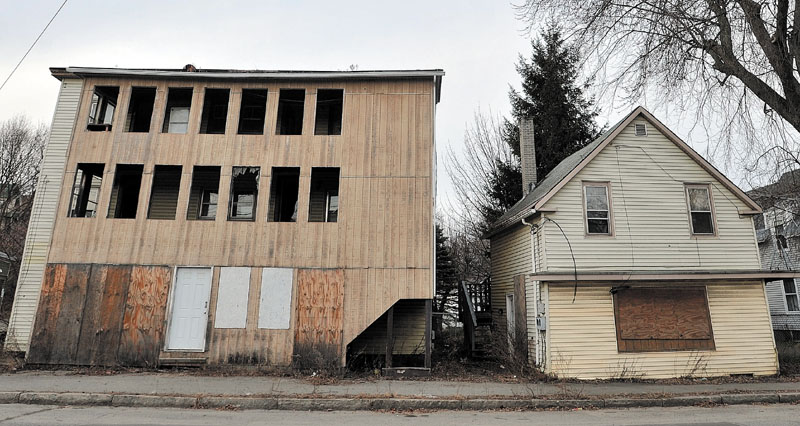 GOING DOWN: Two buildings on Water Street in Waterville are set to be demolished on Monday morning.