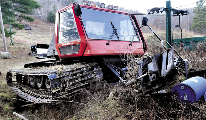 This snow-grooming machine came to a halt in a ditch after apparently running over Eaton Mountain Ski Area owner David Beers while he worked on it Sunday at the Skowhegan facility. Beers had surgery for a dislocated ankle and suffered a broken jaw. His wife, Donna, reported that he is doing better on Monday.