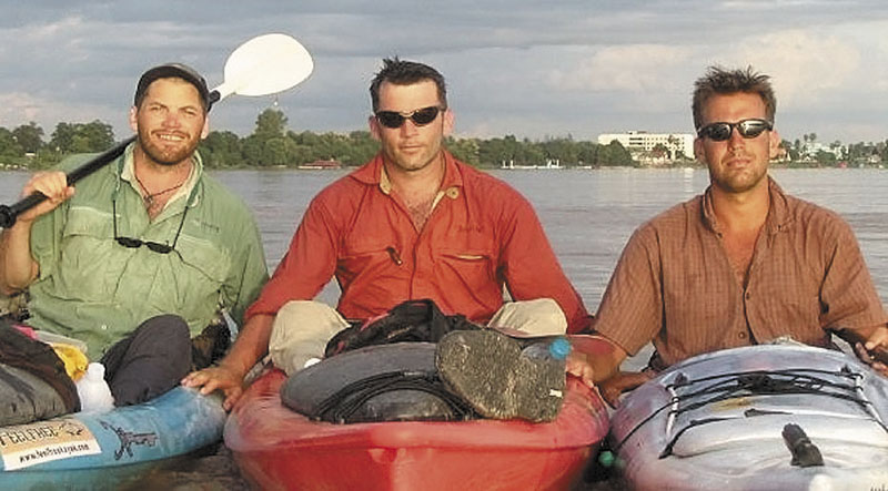 Filmmakers Hutch Brown, left, and Brian Eustis, right, have strong ties to Maine. Also shown is the film's director Mick O'Shea, center. They paused for a photo on the Laos-Thailand border during their trip down the 2,800-mile Mekong River in 2004.