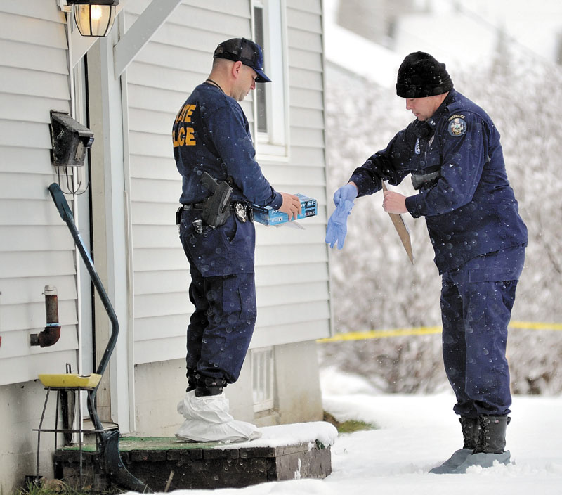 INVESTIGATION CONTINUES: Maine State Police investigators put on latex gloves and booties on Friday morning before entering the Waterville home of Ayla Reynolds, above right.