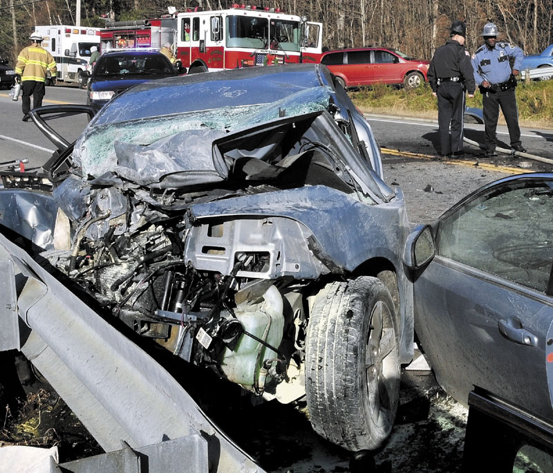 FATAL WRECK: Rescue workers used extrication tools to remove Dawn Poplawski from this car after it collided with an SUV on U.S. Route 2 near the Great Eddy of the Kennebec River in Skowhegan on Thursday. Poplawski, 59, of Canaan, died in the crash.