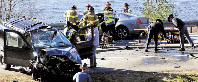 AT THE SCENE: Police and fire officials investigate the scene of a head-on collision of two cars on U.S. Route 2 in Skowhegan on Thursday. Dawn Poplawski, 59, of Canaan, was killed in the crash.