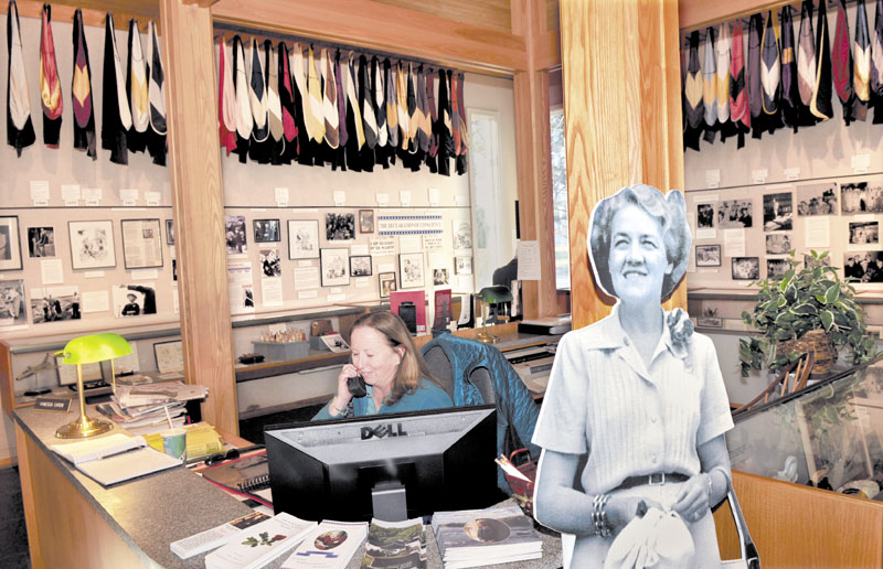 CHANGING HANDS: Margaret Chase Smith Library administrative assistant Vanessa Caron works at her desk beside a life-size image of the Senator at the library in Skowhegan on Monday. Beginning Jan. 1, the University of Maine will assume responsibility for all daily operations and programs at the library.