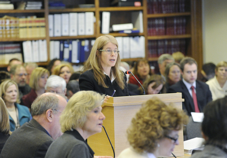 Maine Commissioner of Health and Human Services Mary C. Mayhew speaks to the Joint Standing Committee on Health and Human Services and the Committee on Appropriations & Financial Affairs in a packed room at the State House in Augusta on Wednesday.