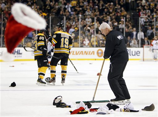 A TD Garden worker clears the ice after Boston Bruins' Brad Marchand (63) scored in the third period of a game against the Florida Panthers on Friday in Boston.