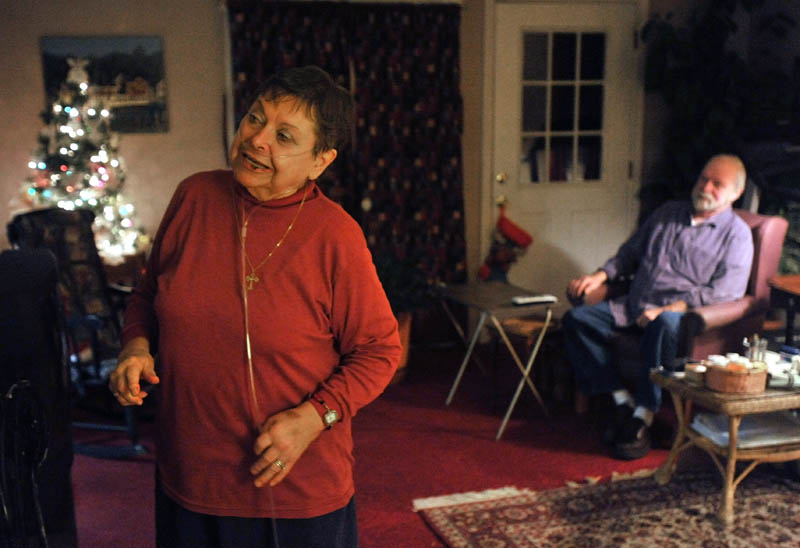 AFFECTED BY CUTS: Jay and Joan Adams at their home in Phillips on Thursday. The Adams live off their social security checks and are having a hard time making ends meet with rising fuel costs.