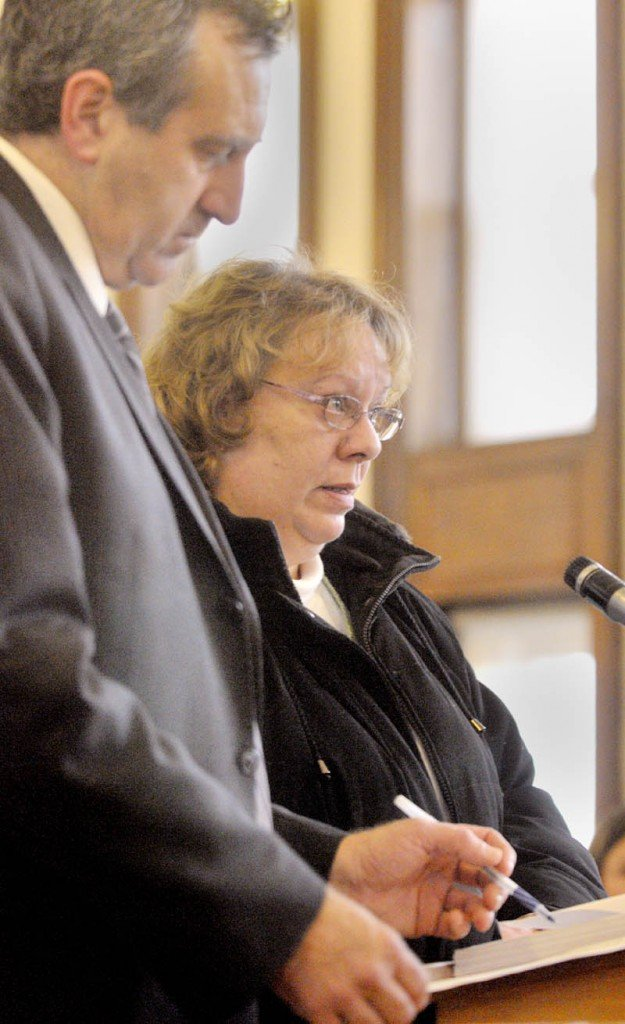 Bettysue Higgins stands with her attorney Ronald Bourget in Kennebec County Superior Court where she pleaded guilty to embezzlement Wednesday morning.