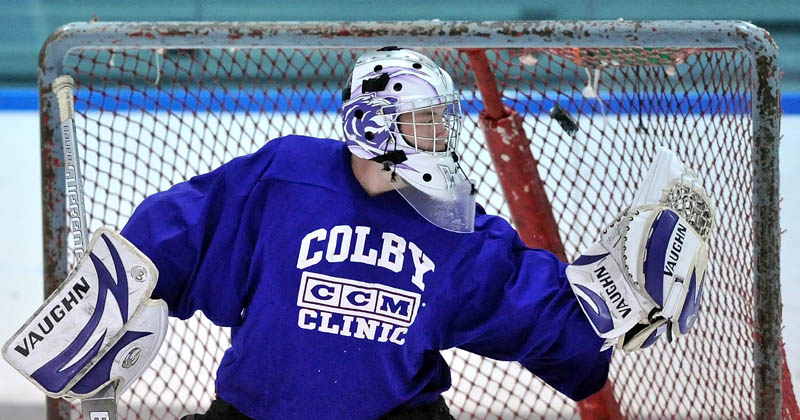 Staff photo by David Robinson Waterville Senior High School goalie Cody Thibodeau, practices with teammates during practice at Alfond Arena at Colby College in Waterville Tuesday.
