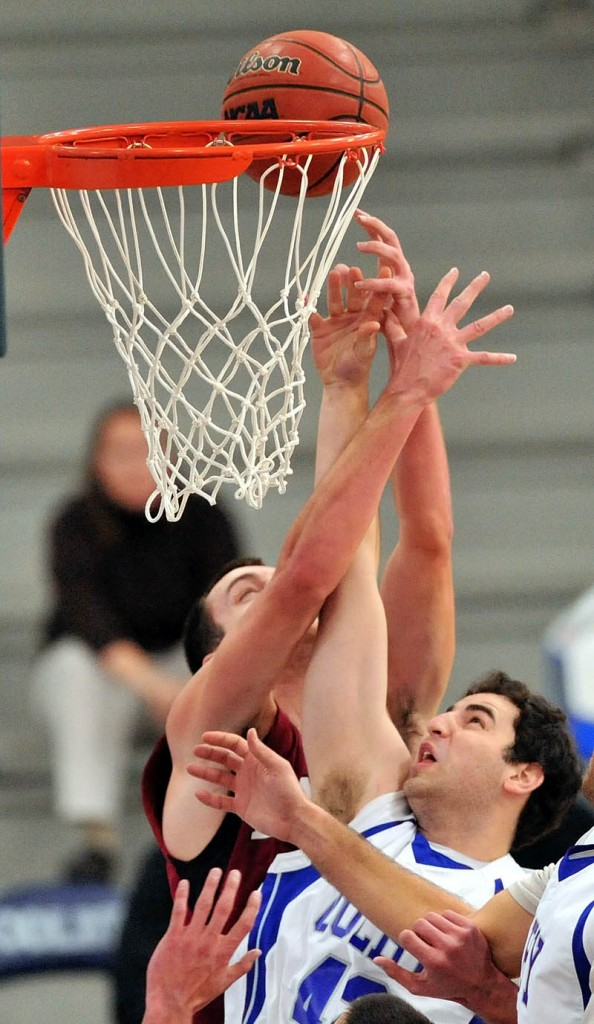 BATTLE FOR THE BOARD: Colby College's Eric Beaulieu, right, battles for a rebound with Bates' John Squires in the first half of the Bobcats' 63-36 win Saturday at Wadsworth Gymnasium in Waterville.