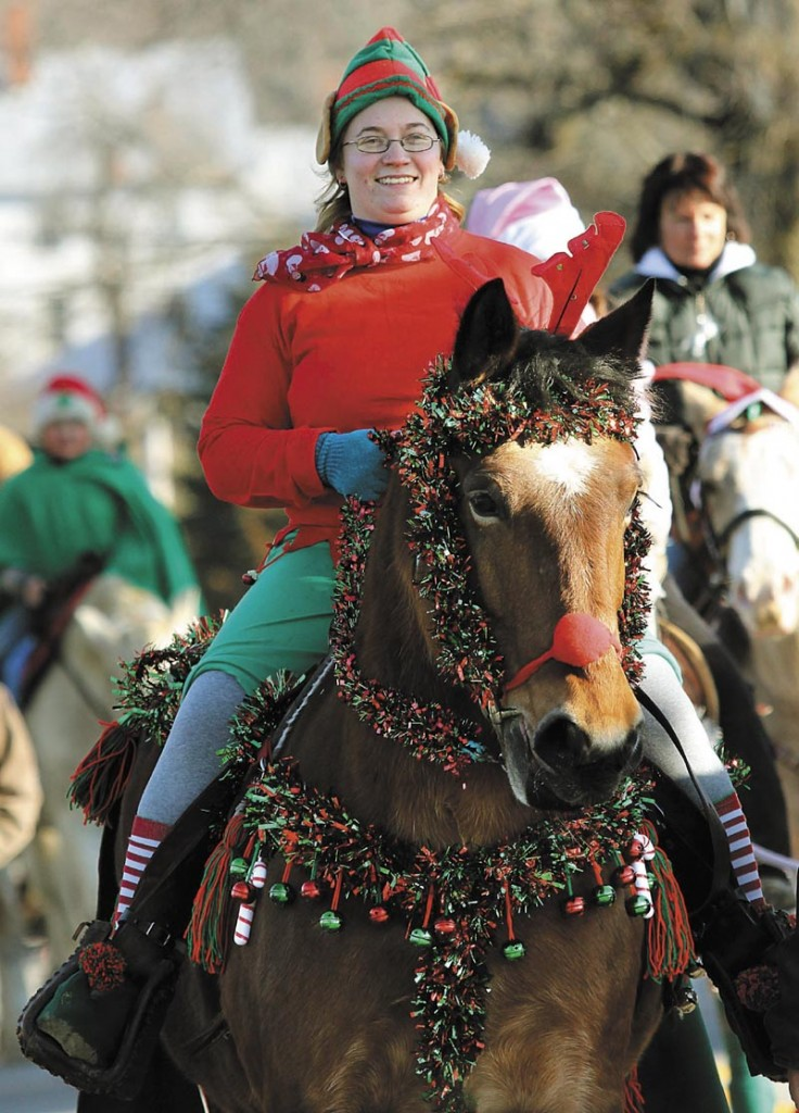 Casey Seavey of Anson rides her horse Classy up Oak Grove Road in North Vassalboro during the 2nd annual Cowboy Christmas Parade on Sunday.