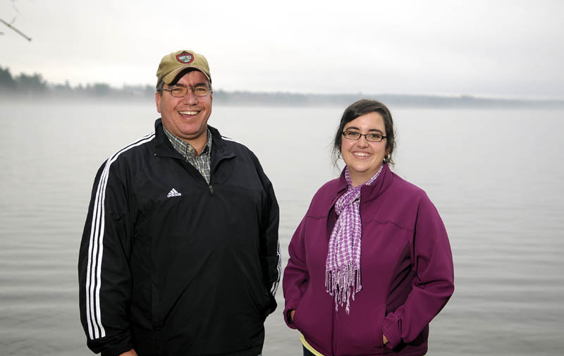 Megan Ferland, right, is home on Cochnewagon Lake in Monmouth with her father, Paul, and mother, Sherry, after being treated for a rare, life threatening form of encephalitis in Boston. The community rallied behind the Ferlands with emotional and financial support during the ordeal.