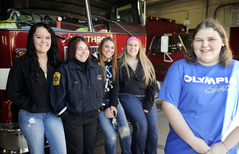 Meg Bateman, 16, right, got money and support from classmates and teachers enrolled in a firefighting class after her home burned. Student Emma Kroemer, left, instructor Marsha Graves, and students Megan Moen and Dakota Strout gave Bateman $400.00 they raised during their class at Mid-Maine Tech Center in Waterville. The group met Monday at the Winthrop Fire Department, where Bateman volunteers, before heading out on a shopping trip to replace items Bateman lost in the blaze last week.